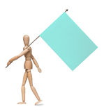 The wooden lay figure marches with a flag on an iron spike. Royalty Free Stock Image