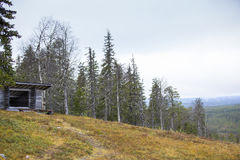 Wooden leanto or a shelter on top of the hill. The original name for this complex is laavu. Royalty Free Stock Photos