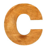 Wooden letter C. Old wooden letter C on wooden background. One of full alphabet wooden set Stock Photography