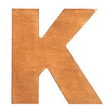 Wooden letter K. Old wooden letter K on wooden background. Vintage wooden letter. One of full alphabet wooden set Royalty Free Stock Photos