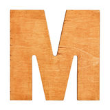 Wooden letter M. Old wooden letter M on wooden background. Vintage wooden letter. One of full alphabet wooden set Royalty Free Stock Photography