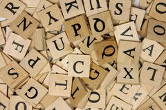 Wooden letter tiles. A pile of wooden letter tiles Royalty Free Stock Photography