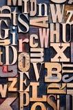 Wooden Letterpress Background. A random selection of wooden letterpress characters as a background, narrow focus royalty free stock image
