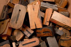 Wooden letters in a box. Cardboard box with lots of wooden typescript letters Stock Photos