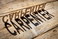 Wooden letters build the word carpenter Stock Photos