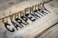 Wooden letters build the word carpentry Stock Photos