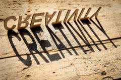 Wooden letters build the word creativity stock photo