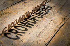 Wooden letters build the word crowdfunding Stock Photos