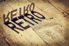 Wooden letters build the word retro Stock Photos