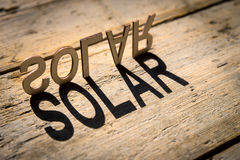 Wooden letters build the word solar Stock Photos