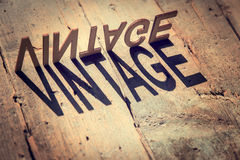 Wooden letters build the word vintage Royalty Free Stock Image