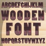 Wooden letters. Dark wood on wooden background Stock Photos