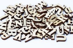 Wooden letters of the English alphabet close-up, background, education concept stock images
