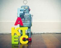 Wooden letters fact fake  on wooden floor robot. Wooden letters fact fake  on wooden floor and retro robot toy Stock Photography