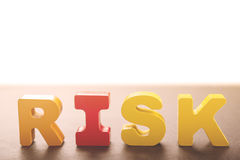 Wooden letters form the word risk Stock Photography