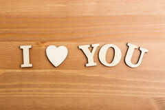 Wooden letters forming with phrase I Love You Stock Photo