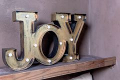 Wooden letters forming word Joy written on grey wall.Christmas postcard. The inscription: Joy to the world. Perfect. Wooden letters forming word DREAM written on stock image