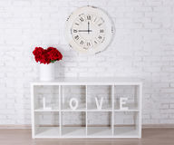 Wooden letters forming word LOVE in modern shelf, flowers and vi Royalty Free Stock Photography