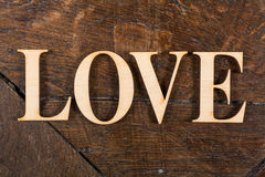 Wooden letters on wooden background Royalty Free Stock Images