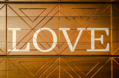 Wooden letters forming word LOVE written on wooden background Stock Photography