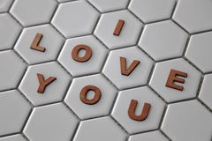 Letters forming the words I love you on hexagon shaped tiles Royalty Free Stock Image