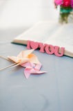 Wooden letters, I love you, pinwheel and book. Stock Photography