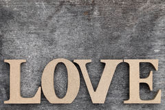Wooden letters love. Word love made with wooden block wooden letters Royalty Free Stock Image