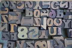 Wooden Letters and Numbers. Closeup of wooden letters and numbers. Horizontally framed shot Stock Photos