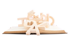 Wooden letters over the book's surface Royalty Free Stock Image