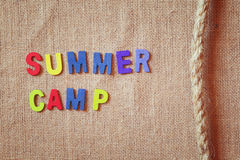Wooden letters with phrase: SUMMER CAMP, and rope Stock Image