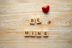 Wooden letters spelling be mine Stock Photos