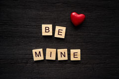 Wooden letters spelling be mine Royalty Free Stock Photo