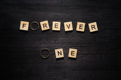 Wooden letters spelling forever one Stock Photo