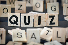 Wooden letters spelling quiz Stock Image