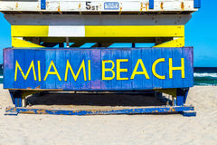 Wooden life guard huts in art deco style in miami Beach. Wooden life guard huts in art deco style at south beach with MIAMI BEACH sign stock photography