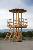 Wooden life guard tower at the sandy beach. Baywatch construction made of wood near to the sea Royalty Free Stock Photography