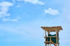 Wooden lifeguard tower against a blue sky. Copy space royalty free stock image