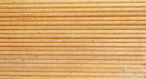 Wooden light brown grooves panel Royalty Free Stock Photos