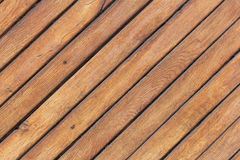 Wooden light brown table with diagonal boards.  Stock Photos