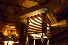 Wooden light chandelier at a ceiling LAtvia stock photo