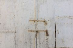 Wooden light grey, old and peeled background. Close up view with details. Space for text. Wooden light grey, old and peeled door for backdrop. Close up view Royalty Free Stock Photography