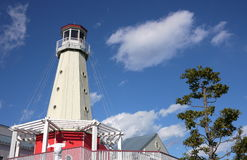 Wooden Light house. White wooden light house under blue sky Stock Photos