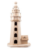 Wooden lighthouse. Model wooden lighthouse natural color, not painted Stock Photos