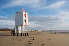 Wooden lighthouse on a beach Stock Photo