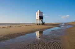 Wooden lighthouse on a beach Royalty Free Stock Photo