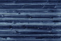 Wooden lining boards wall. dark blue wood texture. background old panels, Seamless pattern. Horizontal planks stock photo