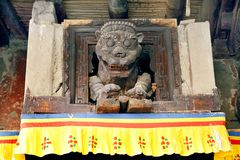 Wooden lion at the entrance of the Leh Palace Stock Photo