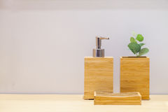 Wooden liquid soap bottle with small tree and soap pad . Bathroom Cosmetics. Bathroom accessories. Hygiene concept. royalty free stock photos