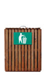 Wooden Litter Bin. Wooden slatted litter bin with metal sign in white and green. Isolated over white background Royalty Free Stock Photography