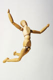 The wooden little man. The wooden flying little man on a white background Stock Photography